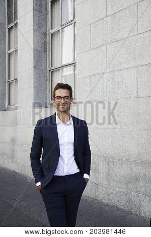 Handsome Businessman smiling in sharp suit portrait