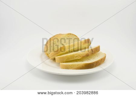 white bread figuratively sliced on a white plate