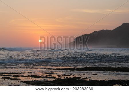 a picture of an afternoon sunset by the beach