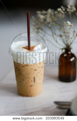 Iced Coffee Whipped Milk  In Coffee Shop On Tabled