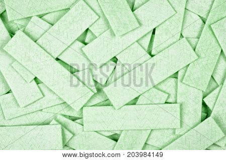 Green chewing gum background with textured surface