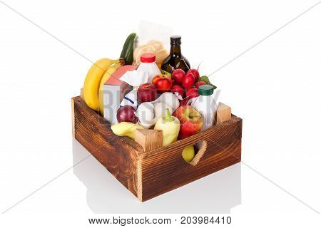 Delivery Concept. Wooden crate with groceries fruits vegetables food and drink isolated on white background.