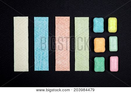 Top View Of Organized Chewing Gum On Black