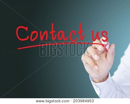 businessman hand write word contact us in red