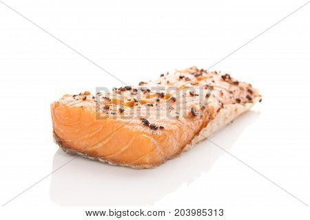 Delicious salmon piece isolated on white background.