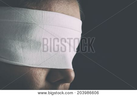 Blindfolded woman closeup. Concept of censorship human rights oppression or repression.