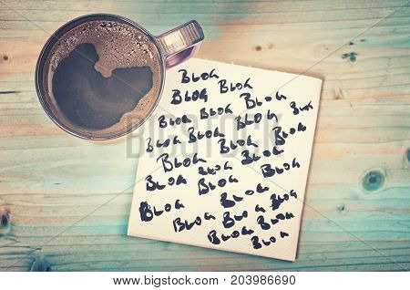 Blog blog blog - blogging concept on a napkin with cup of espresso coffee