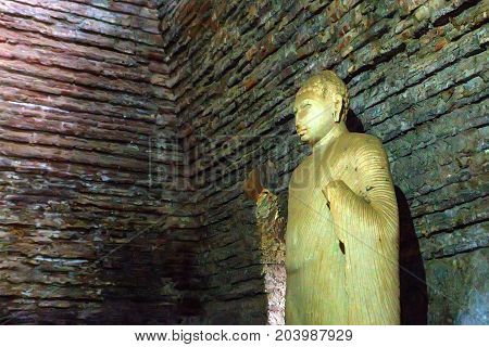 Ancient Buddha sculpture inside the Image House or Thuparama in the world heritage city Polonnaruwa, Sri Lanka