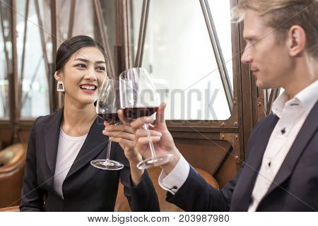 Woman Testing Wine With Attracitve Smiling At Restaurant. People Drinking Wine With Relax Emotion.