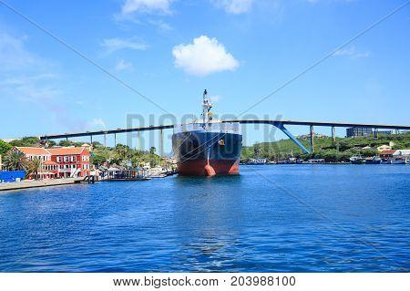 A Massive Tanker Moored Under Curacao Bridge