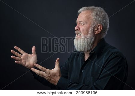 Old man with beard praying for someone and asking for something