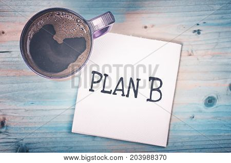 Plan B on a napkin and cup of coffee