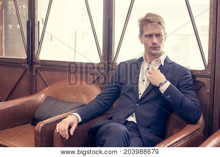 Portrait Of A Handsome Businessman Sitting In Restaurant, Man With Business Concept. Vintage Tone.