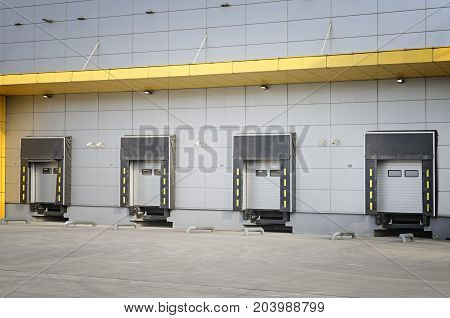 Detail of modern storage units building with sliding garage doors. Closed doors of the modern industrial storage warehouse.