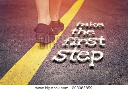Take the first step inspirational concept on the road