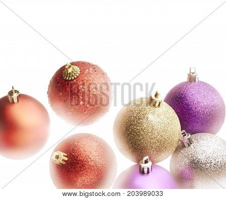 High key light effect on a colorful christmas balls set. White background and copy space