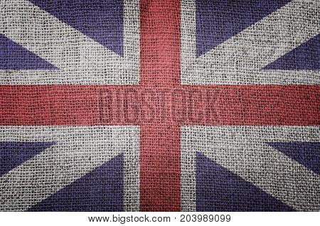 British flag on vintage jute background texture