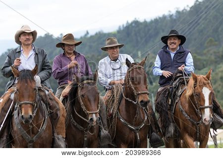 May 27 2017 Sangolqui Ecuador: cowboys from the Andes region on horseback traveling to a rural rodeo