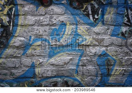 Old grunge painted brick wall background detail