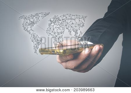 Hand holds mobile smart phone worldwide connection and social network concept. Smart business concept.