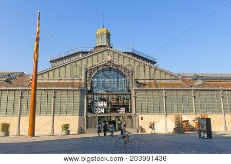 BARCELONA SPAIN - JUNE 1 2017: The facade of Born market and flag of Catalonia. It is an example of iron architecture a movement within the modernist. Born district. Barcelona Catalonia Spain