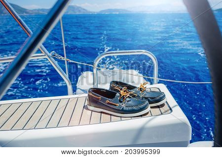 Navy top sider shoes with lifebuoy, binoculars on the wood background