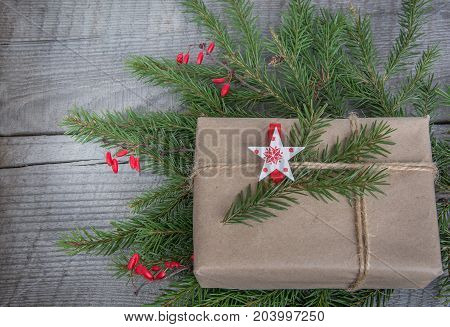 New year gift box handicraft wrapping parchment twine fir tree twigs cute simple last minute present handmade. Top view.