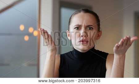 Angry Woman in Office Unhappy at Work in Office