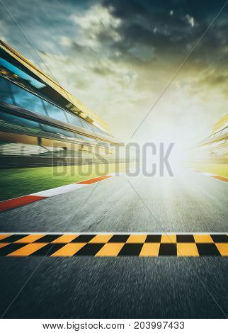View of the infinity empty asphalt international race track starting or end line Motion blurred effect.