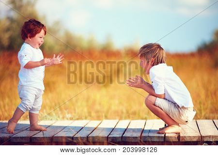 Cute Happy Kids, Brothers Playing Together On Summer Field