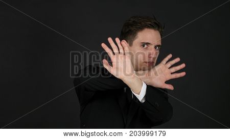 Rejecting Opposing Businessman Dark Black Background in Studio