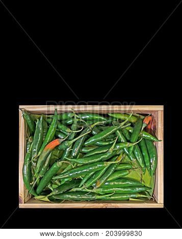 Green Cayenne Pepper in The Wooden Box Isolated on Black Background Clipping Path