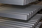 Profiled galvanized sheet in packs at the metal products warehouse Russia poster