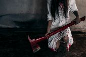 Zombie woman or ghost holding axe sitting with blood in house of ruin nightmare horror of scary fear on hell is monster devil in halloween festival. poster