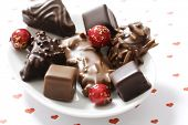 assortment of chocolate covered gingerbread with almonds and nuts poster