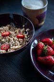 Porridge with strawberries close-up. Flakes are polly, oatmeal with strawberries. Cheese, bread. Healthy diet, diet, vitamins poster