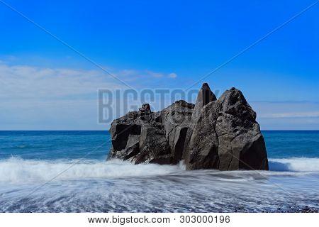 Rock Formation On The Beach Against Clear Blue Sky. Praia Formosa Beach In Funchal On Portuguese Isl