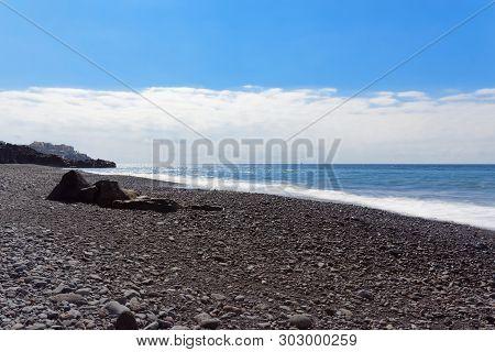 Nature Scene Of Stone Beach Against Blue Sky. Praia Formosa Beach In Funchal On Portuguese Island Of