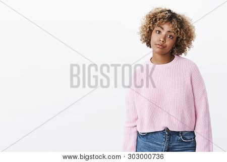African-american Girl Looking With Dismay And Annoyance Smirking From Dislike And Regret Stooping Wi