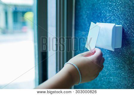 Door Access Control. Boy Holding A Key Card To Lock And Unlock Door At Home Or Condominium.