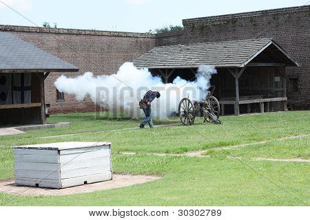 Civil war soldier firing a canon