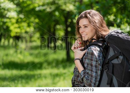 Happy Tourist Camper Girl With Backpack Outdoors