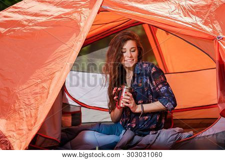 Happy Girl In Tent With Thermos Bottle