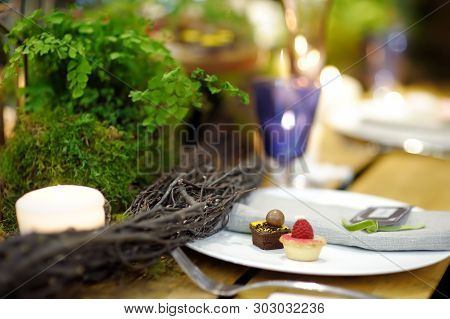 Table Set For An Event Party Or Wedding Reception In Rustic Or Scandinavian Style Decorated Moss And