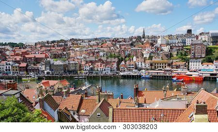 Whitby, England - Aug 2017: View From The Iconic 199 Steps Near Whitby Abbey Down Into The Harbor Wi