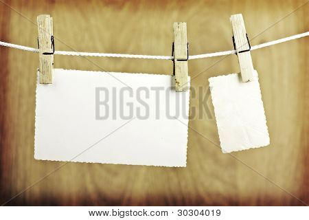 Photos hanging on the clothesline