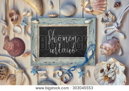 Blackboard With Maritime Decorations On Light Wood, Text In German,