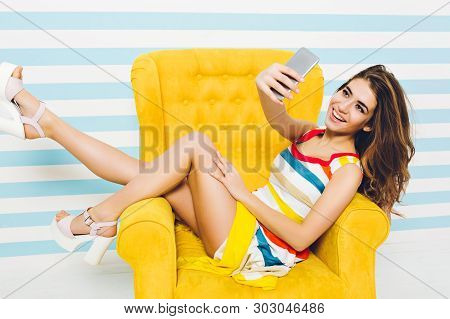 Happy Summer Time Of Joyful Stylish Ypung Woman In Colorful Dress, With Long Brunette Curly Hair Mak
