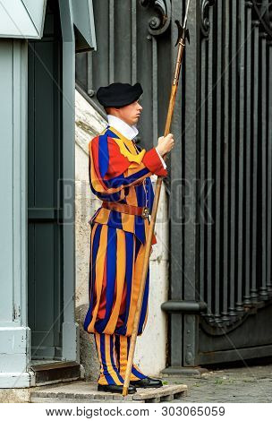 Vatican City, Rome - April 21, 2019: Traditional Papal Swiss Guard With Halberd In Front Of A Sentry