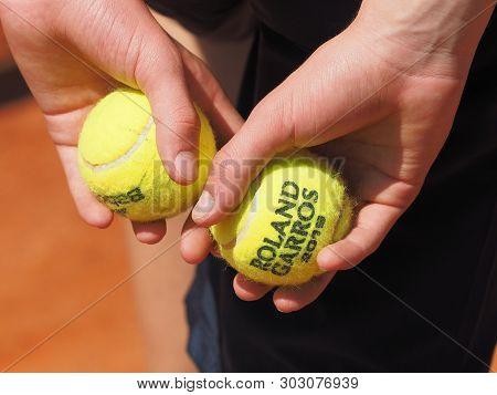 Paris, France - May 26, 2019: Ball Kid Holding Several Roland Garros 2019 Tennis Balls Behind His Ba